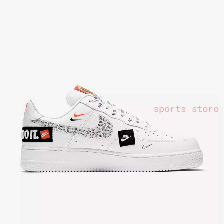 """0c456aeeb0db66 ... Force 1 Low features a White leather upper with Orange and Black  contrasting accents. Highlighting the shoe are """"Just Do It"""" branding and  patches ..."""