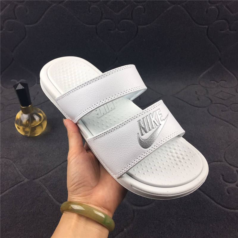 fb2775583f92 Buy Nike Nike Benassi Duo Ultra black and white straps Ninja men and ...